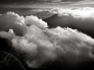 Aerial View Of Clouds Partially Obscuring Ambrym Volcano by Stephen Alvarez Pricing Limited Edition Print image