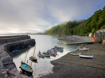 Fishing Boats Moored In The Harbour At Clovelly, Devon, England, United Kingdom, Europe by Adam Burton Pricing Limited Edition Print image