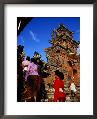 Women Bearing Offerings At Tagtag Temple, Denpasar, Indonesia by Tom Cockrem Pricing Limited Edition Print image