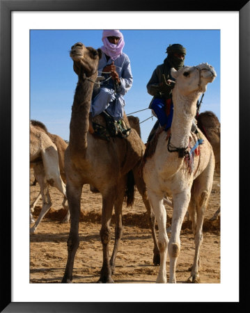 Two Taureg Men On Camels At Sahara Festival, Douz, Tunisia by Pershouse Craig Pricing Limited Edition Print image