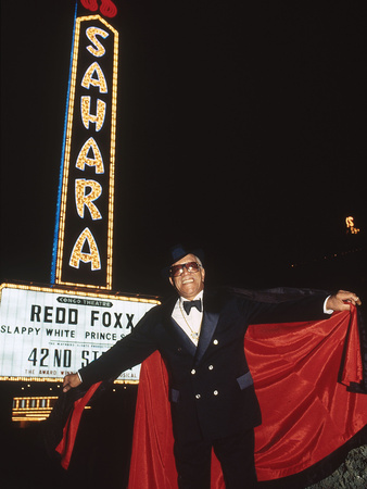 Comedian Redd Foxx Stands In Front Of His Marquee, Sahara Hotel And Casino by Vandell Cobb Pricing Limited Edition Print image