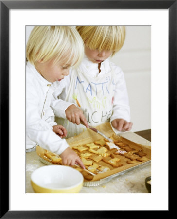Two Children Brushing Biscuits With Glace Icing by Renate Forster Pricing Limited Edition Print image