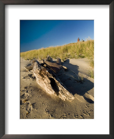 Driftwood On The Beach With A Lighthouse In The Background, Block Island, Rhode Island by Todd Gipstein Pricing Limited Edition Print image