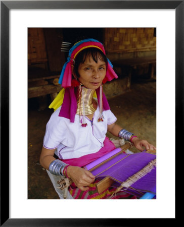 Portrait Of A 'Long Necked' Padaung Tribe Woman Weaving On A Hand Held Loom, Mae Hong Son Province by Gavin Hellier Pricing Limited Edition Print image