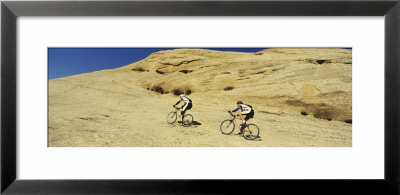 Two Men Mountain Bilking On Rocks, Slickrock Trail, Moab, Utah, Usa by Panoramic Images Pricing Limited Edition Print image