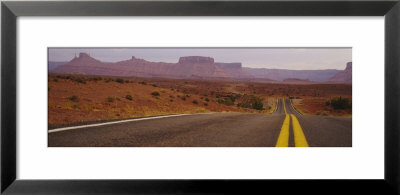 Highway Passing Through An Arid Landscape, Monument Valley Tribal Park, Arizona, Usa by Panoramic Images Pricing Limited Edition Print image