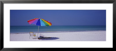 Beach Umbrella And A Folding Chair On The Beach, Fort De Soto Park, Tierra Verde, Florida, Usa by Panoramic Images Pricing Limited Edition Print image
