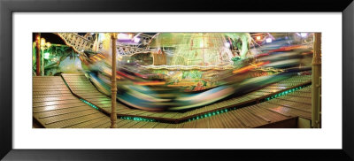 Carousel In Motion, Amusement Park, Stuttgart, Germany by Panoramic Images Pricing Limited Edition Print image