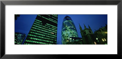 Buildings Lit Up At Night, Sir Norman Foster Building, Swiss Re Tower, London, England by Panoramic Images Pricing Limited Edition Print image