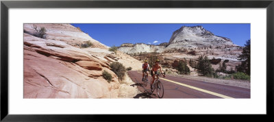 Two People Cycling On The Road, Zion National Park, Utah, Usa by Panoramic Images Pricing Limited Edition Print image