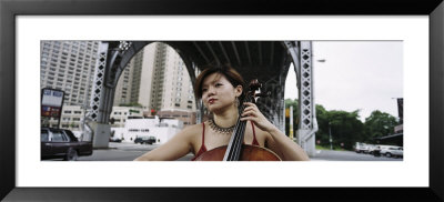 Young Woman Playing A Cello, New York City, Nyc, New York State, Usa by Panoramic Images Pricing Limited Edition Print image