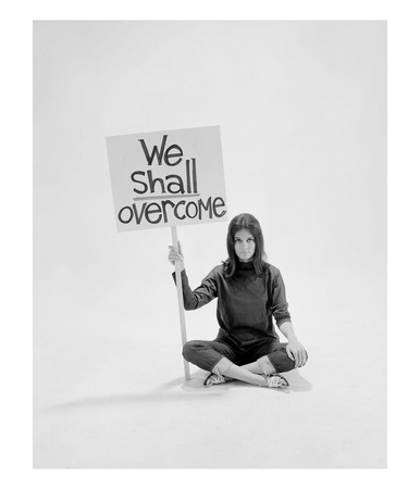 Writer Gloria Steinem Sitting On Floor With Sign We Shall Overcome Regarding Pop Culture by Yale Joel Pricing Limited Edition Print image