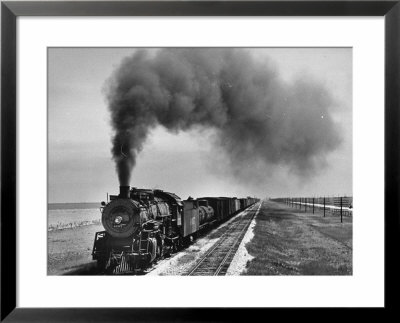 View Of A Freight Train Crossing An Open Prairie by Thomas D. Mcavoy Pricing Limited Edition Print image