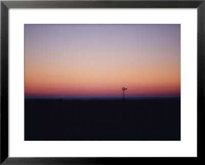 A Windmill Breaks The Flat Horizon Of The Texas Panhandle At Dawn by George F. Mobley Pricing Limited Edition Print image