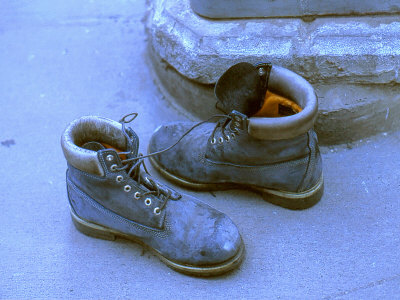 Pair Of Boots Left By Ground Zero Site, New York City by Images Monsoon Pricing Limited Edition Print image
