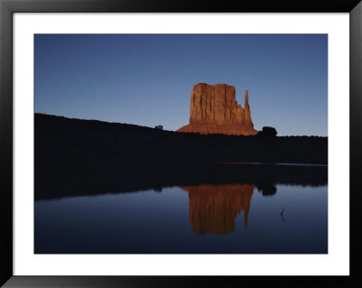 Sunrise By A Lake In Monument Valley by Michael Nichols Pricing Limited Edition Print image