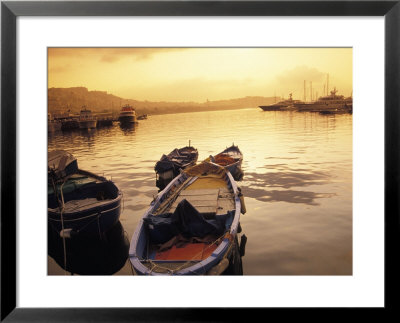 Sunset Setting Over Two Boats At A Fishing Harbour And Marina On The Bay Of Naples In Naples, Italy by Richard Nowitz Pricing Limited Edition Print image