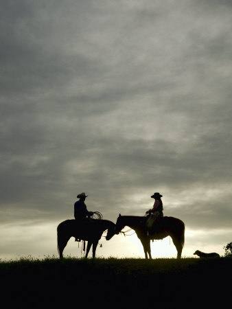 Cowboy And Cowgirl On Horseback In Silhouette At Sunset by Scott Stulberg Pricing Limited Edition Print image