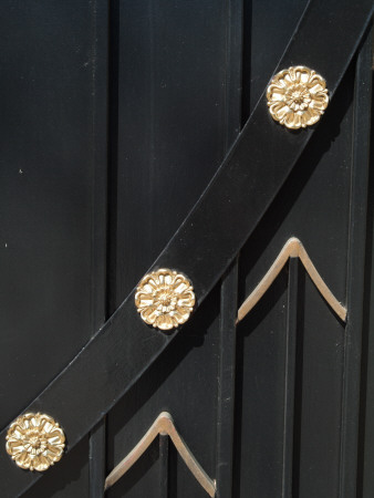 Backgrounds - Detail Of Black Stained Wooden Gate Decorated With Gold Medallions And Chevrons by Natalie Tepper Pricing Limited Edition Print image