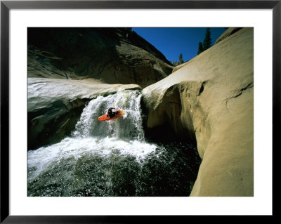 Suspended In Mid-Air, A Kayaker Sails Down A Short Waterfall, Headed For The White Water Below by Barry Tessman Pricing Limited Edition Print image