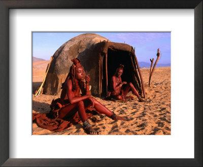 Himba Women In Front Of Traditional Hut, Kaokoveld, Kunene, Namibia by Ariadne Van Zandbergen Pricing Limited Edition Print image